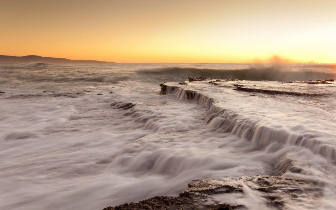 ocean sea waves sunset sunrise coast shore beaches sky wallpaper