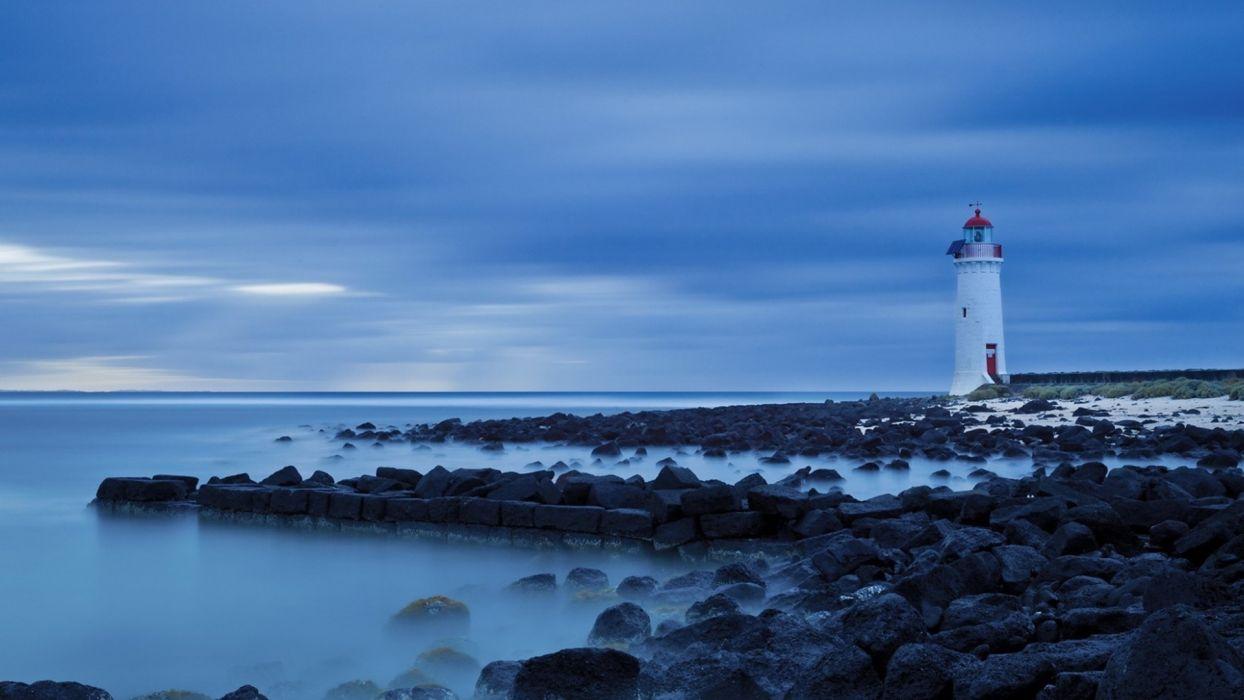 world architecture buildings lighthouse coast shore ocean sea stones rock sky clouds wallpaper