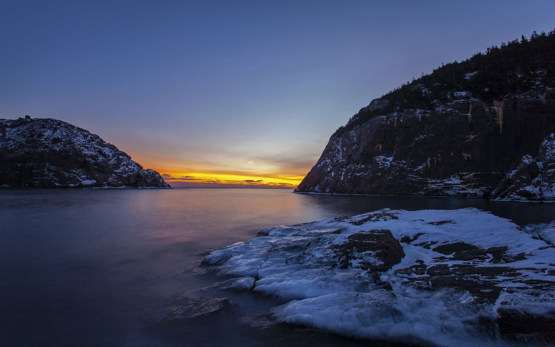 nature landscapes cliff winter snow sky sunset sunrise ocean sea inlet wallpaper