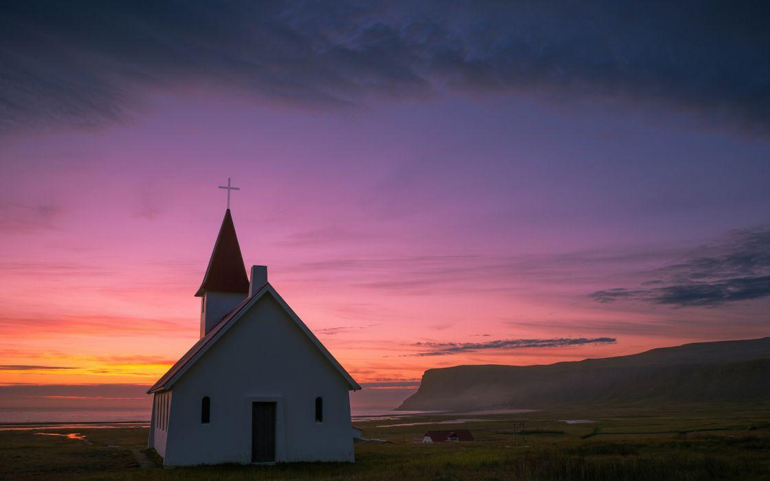 Iceland nature landscapes coast shore cliff hill village town architecture buildings church steeple cross sky sunset sunrise clouds ocean sea wallpaper