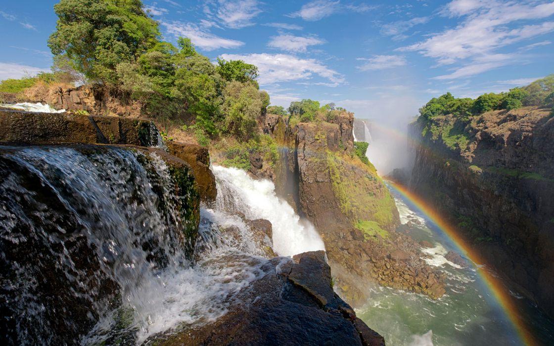 waterfalls nature landscapes rivers drops spray splash mountains cliff gorge stone rocks rapids fog mist rainbow jungle trees wallpaper