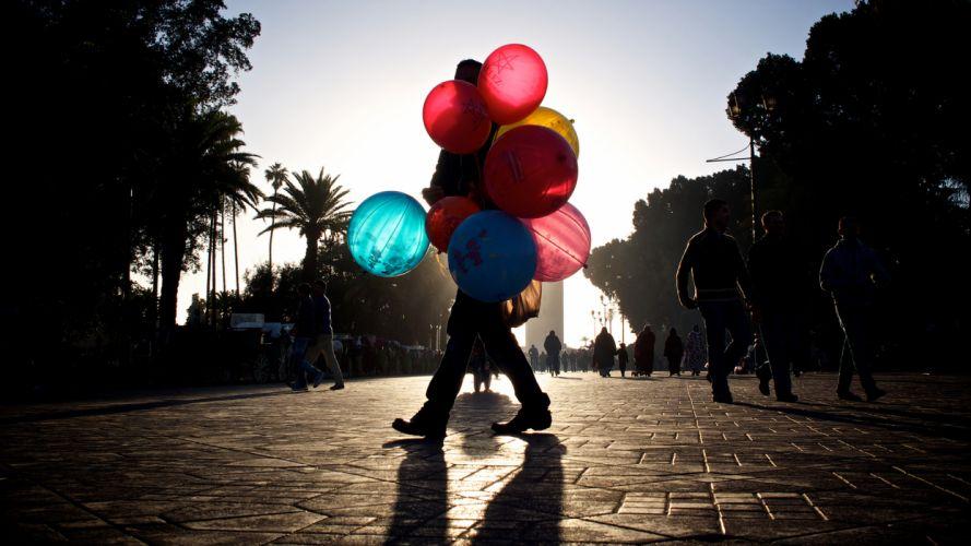 Balloons people mood sidewalk men women males females children sky wallpaper