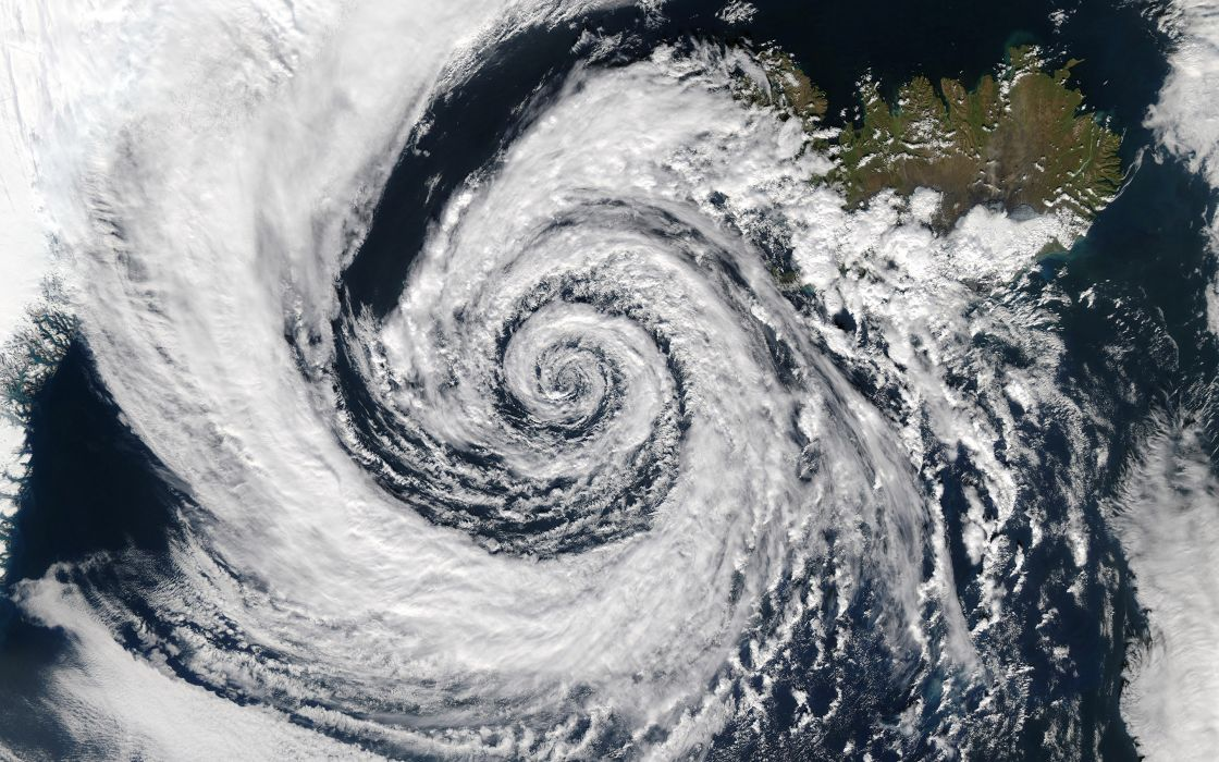 Storm Clouds Aerial earth planets hurricane typhoon landscapes ocean sea pattern swirl clouds wallpaper