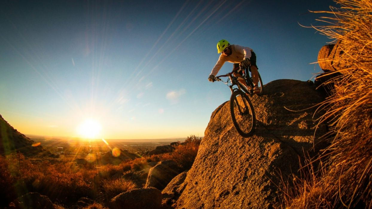 mountain bike man cyclist sunrise sunset landscapes sky sunlight beams rays people men extreme stone rock wallpaper