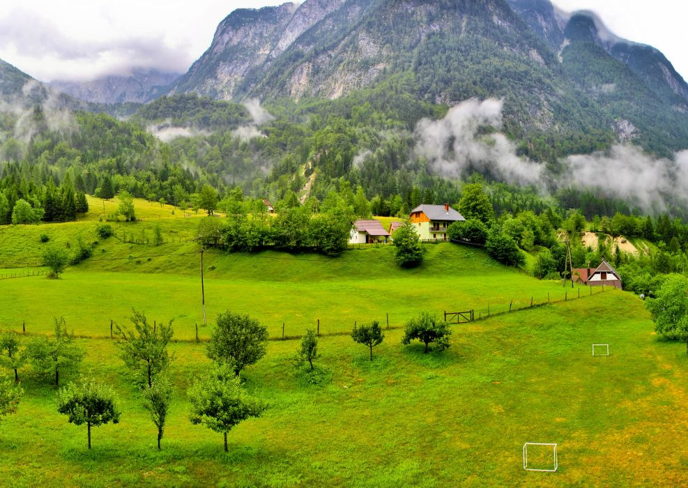 Bovec Slovenia Mountains Grass Nature landscapes fields grass trees forest mountains fog clouds woods fence rustic farm architecture buildings houses wallpaper