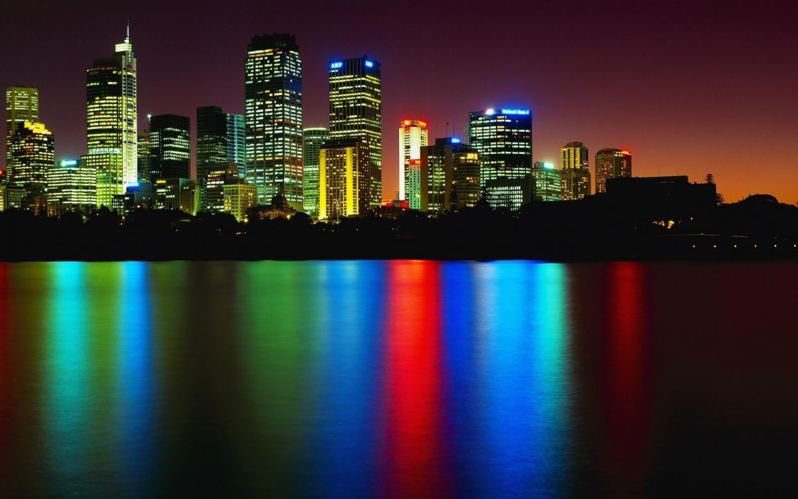 skyscraper buildings architecture cities skyline cityscape bay water reflection rainbow color night lights wallpaper