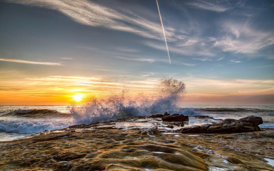 waves splash spray drops beaches shore coast ocean sea sunset sunrise sky clouds wallpaper