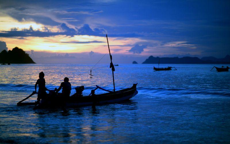 Boat Silhouette Ocean Sunset Blue sea sky clouds mood people wallpaper