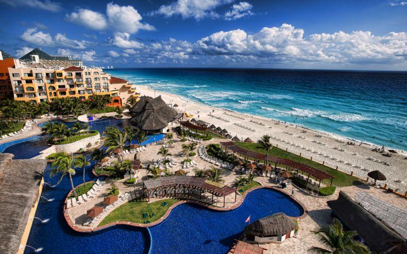 Resort Pool Tropical Beach Ocean Hotel ocean waves sky clouds wallpaper