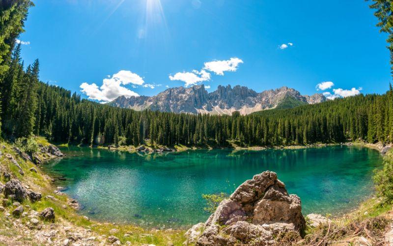 lake lago di carezza wood stone trees mountasins sky wallpaper