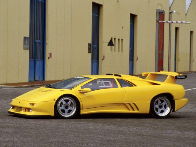 lamborghini Diablo Lamborghini yellow building tuning spoiler supercar wallpaper