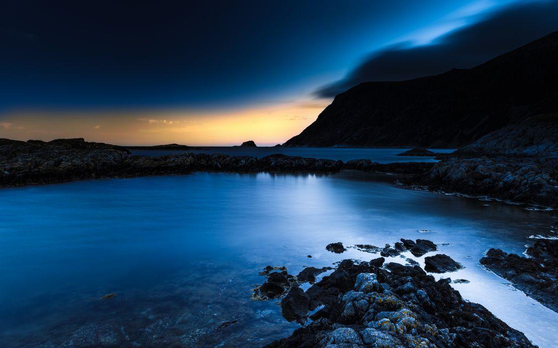 Ocean Rocks Stones sky sunset mountains clouds wallpaper