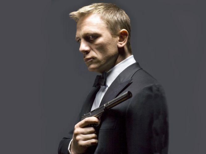 Daniel Craig actor James Bond agent 007 Tuxedo gun weapons actor men males wallpaper