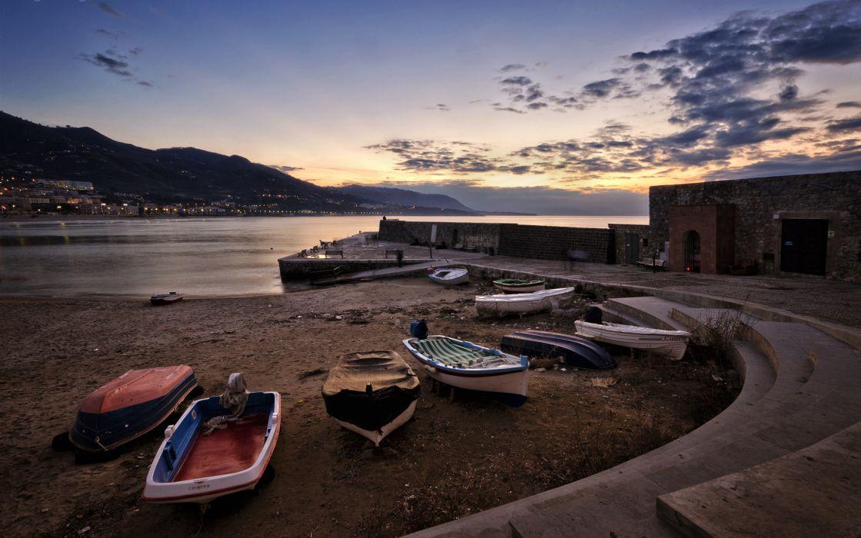 Boats Shore Ocean beaches sunset sky wallpaper