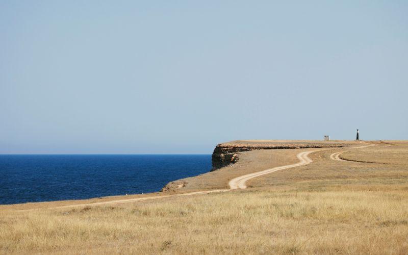 sea aeYaeY beach road lighthouse grass ocean sky wallpaper