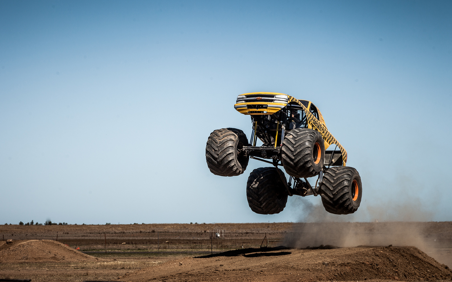monster truck jump stop action wallpaper 1920x1200