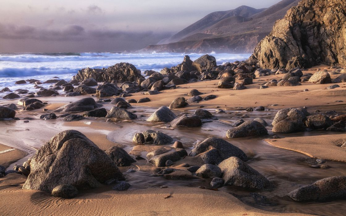 beach sand stones ocean sea waves sky clouds coast wallpaper