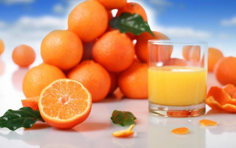 juice orange juice fruit oranges citrus fruits glass leaves wallpaper