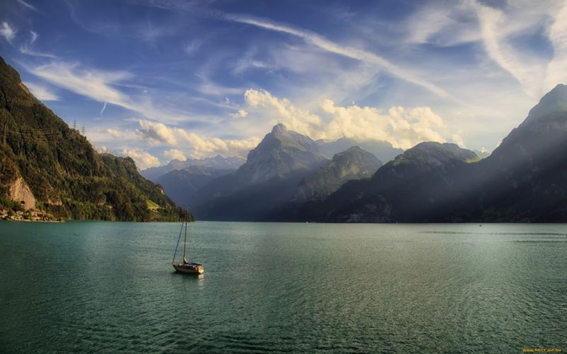 switzerland lake boats mountains clouds wallpaper