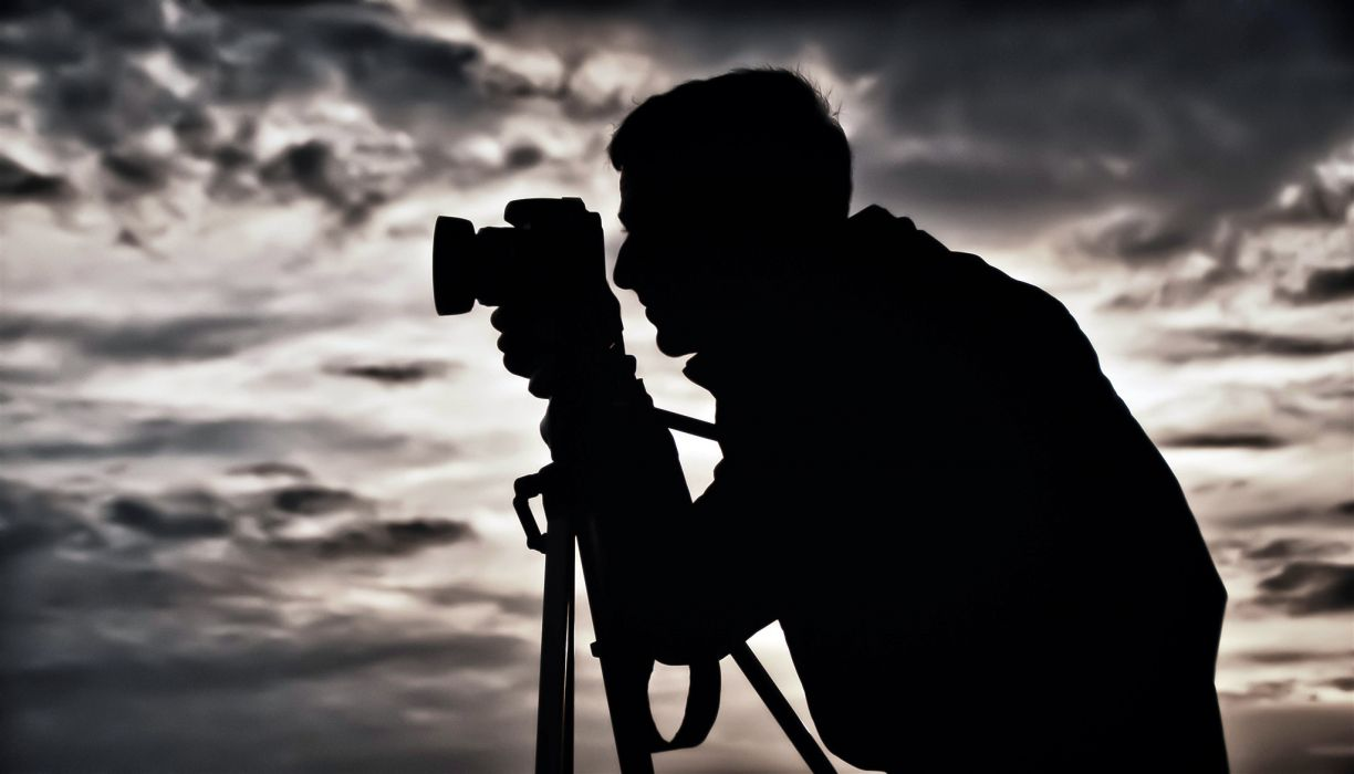 Man silhouette photographer tripod camera background sky clouds men males wallpaper