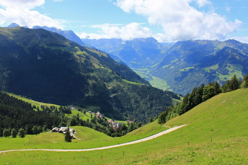 Mountains Switzerland Scenery Grass Nature houses buildings trees forest wallpaper