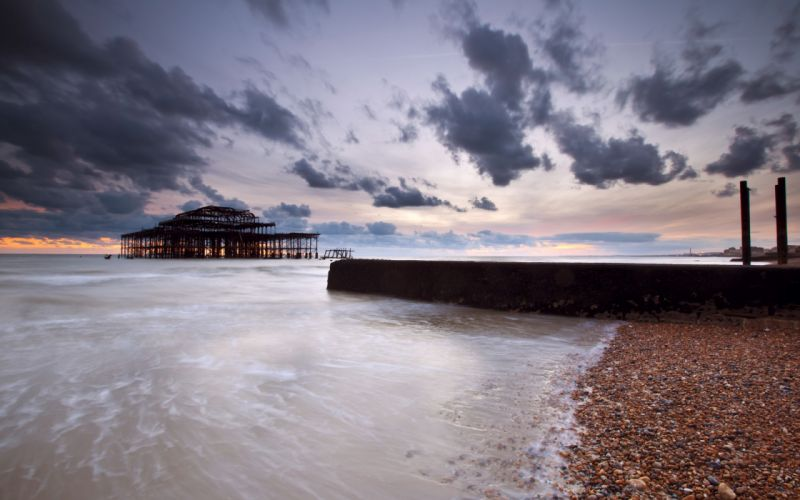 UK England sea strait shore rocks pier night sunset sky clouds ocean beaches wallpaper