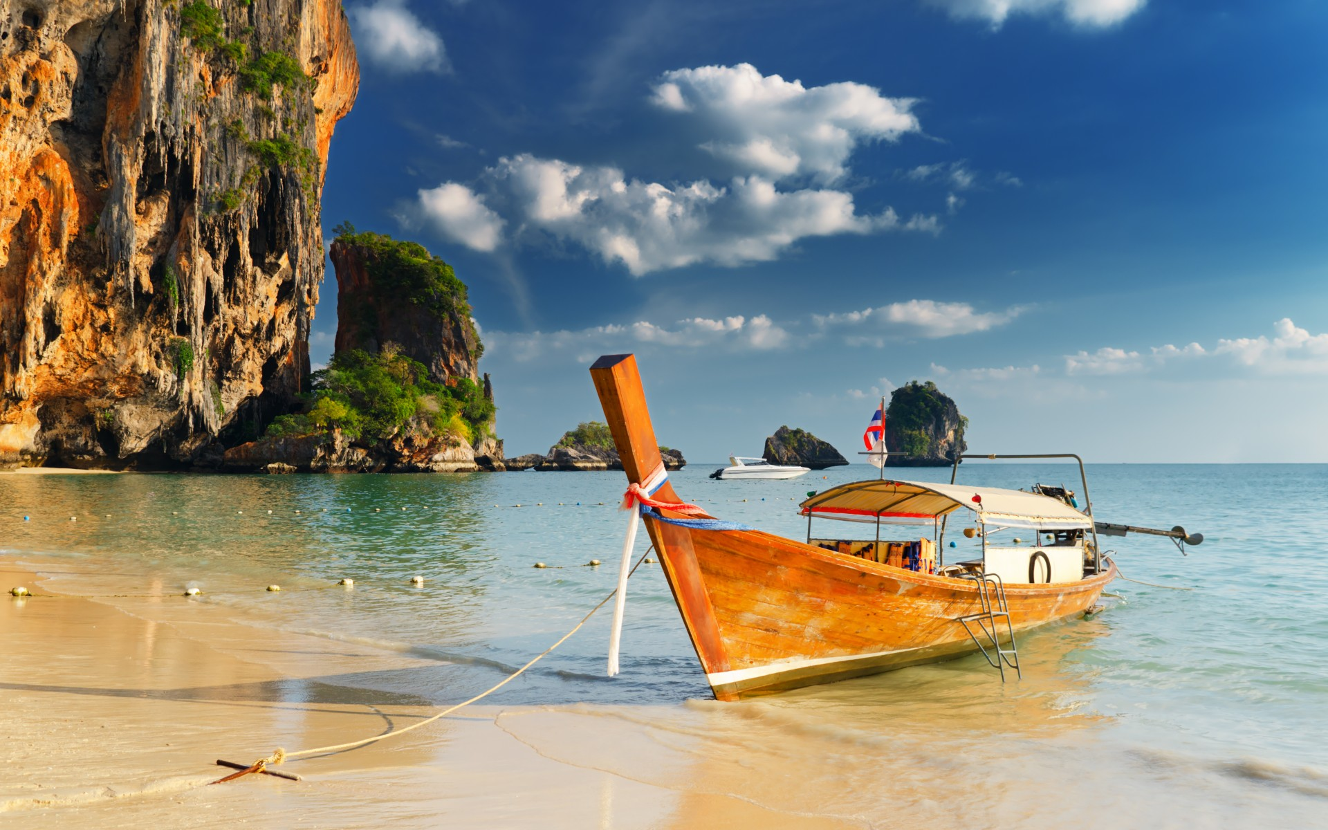 Sea beach boat rocks clouds sand ocean cliff sky clouds shore