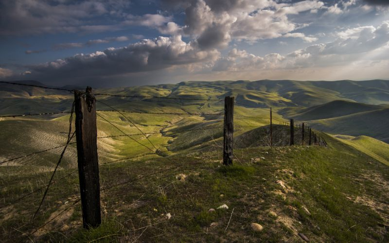 Fence Barb Wire Grass Landscape Clouds hills mountains sky wallpaper
