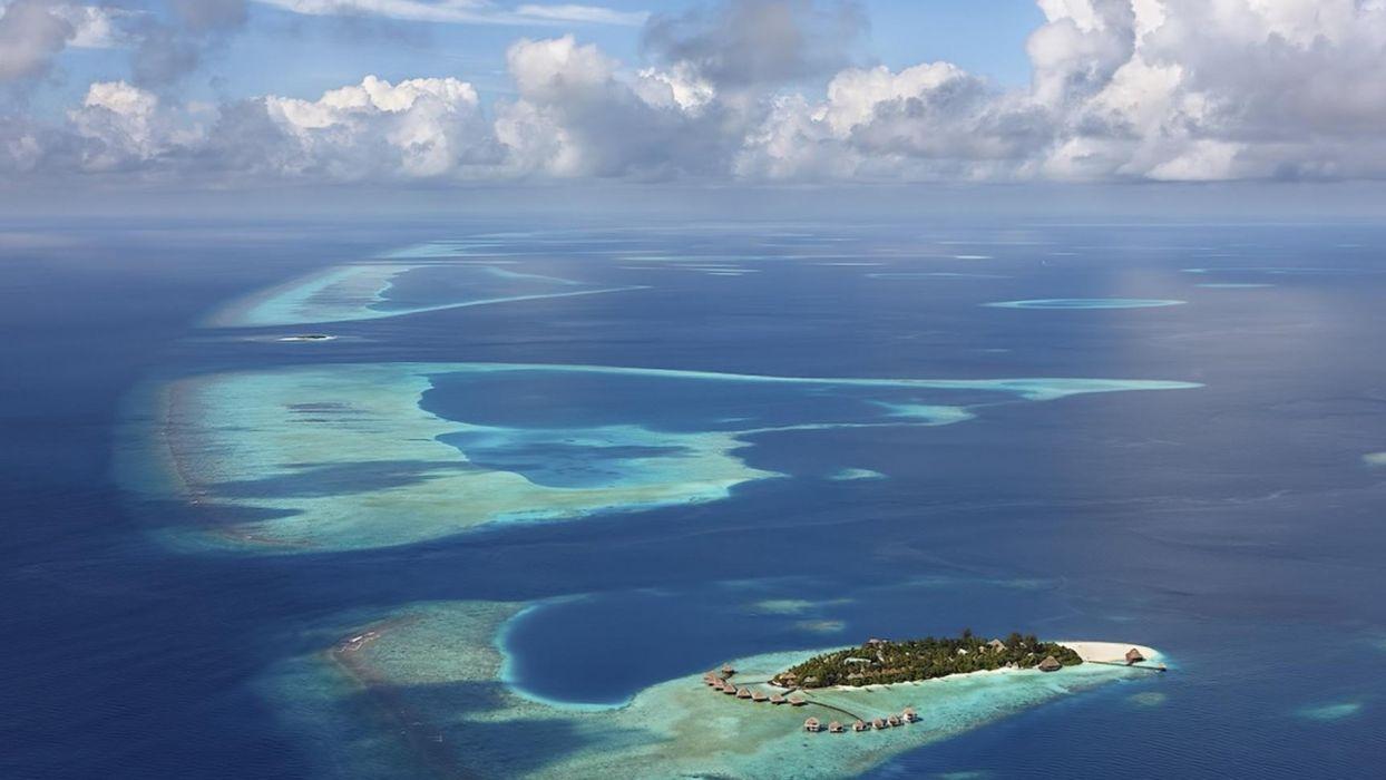 landscapes islands beaches sea ocean resort buildings sky clouds wallpaper