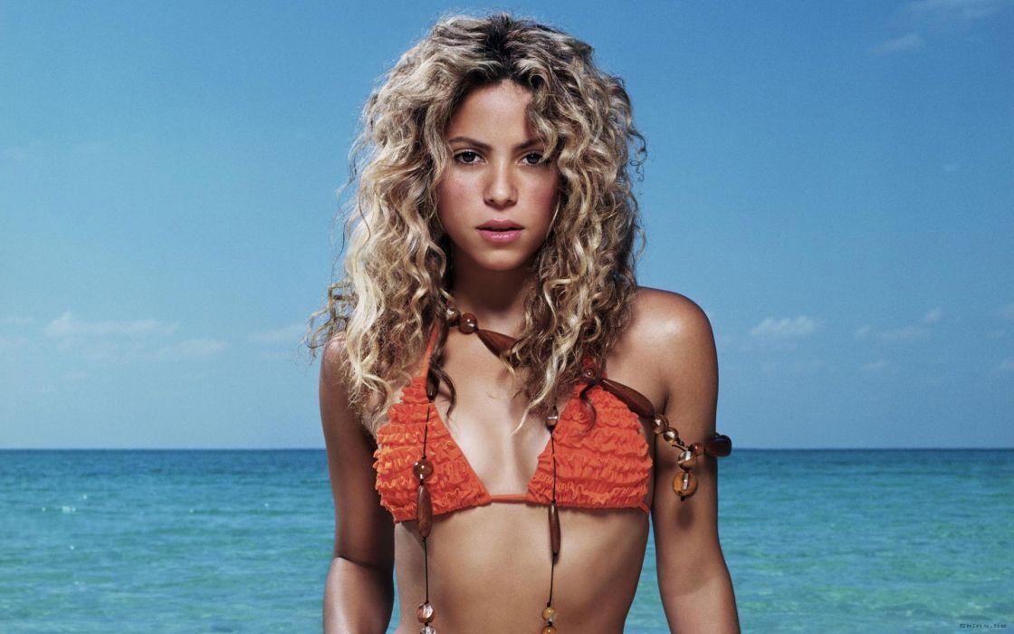 Shakira singer musician blondes women females girls sexy babes face eyes cleavage bikini swimwear wallpaper