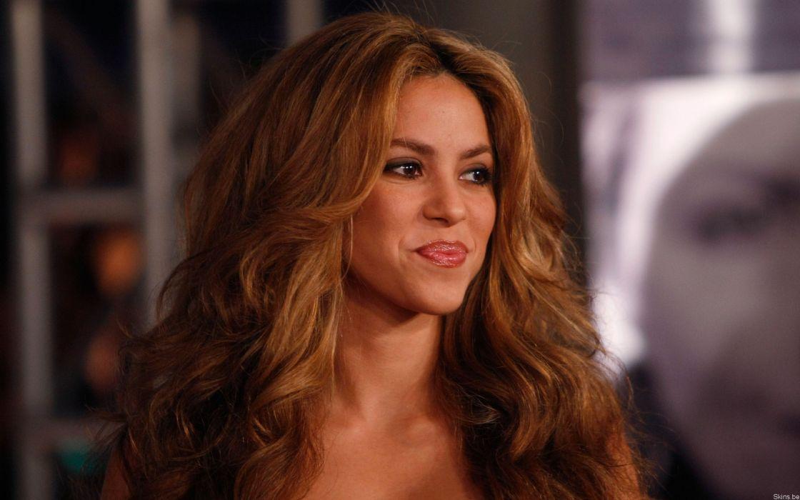 Shakira singer musician blondes women females girls sexy babes face eyes        a wallpaper