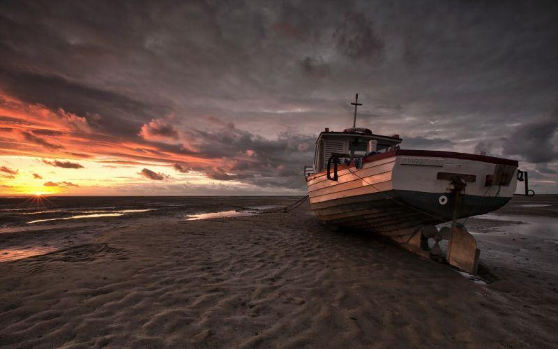 clouds beach sand boats wallpaper