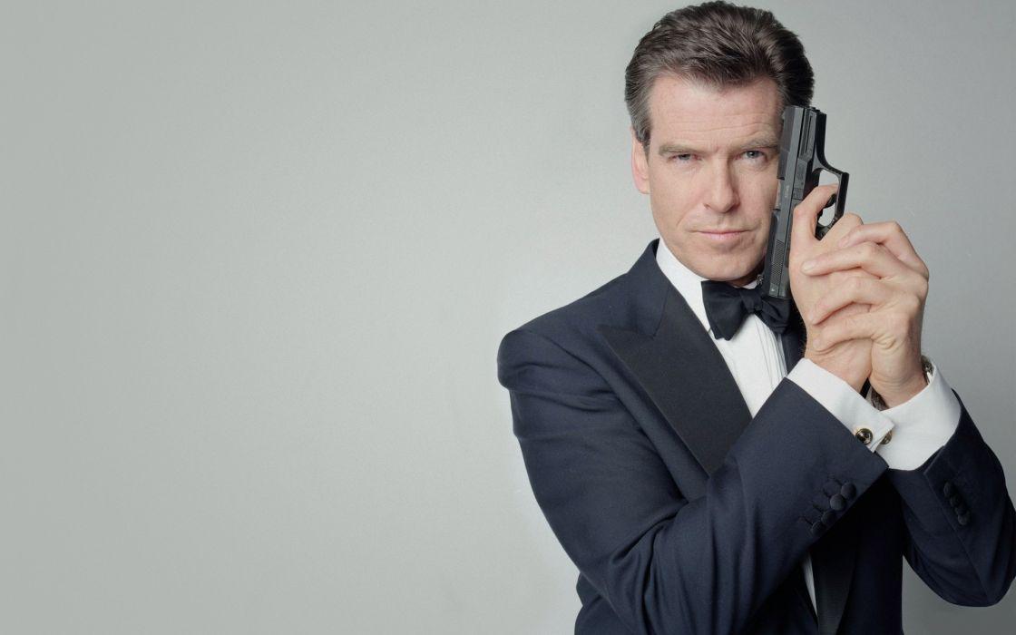 Pierce Brosnan  Agent 007  James Bond weapons guns pistol men males actors wallpaper