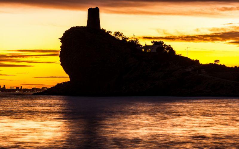 Sunset Ocean Coast landscapes sky clouds buildings ocean sea water reflection color ruins lighthouse islands wallpaper