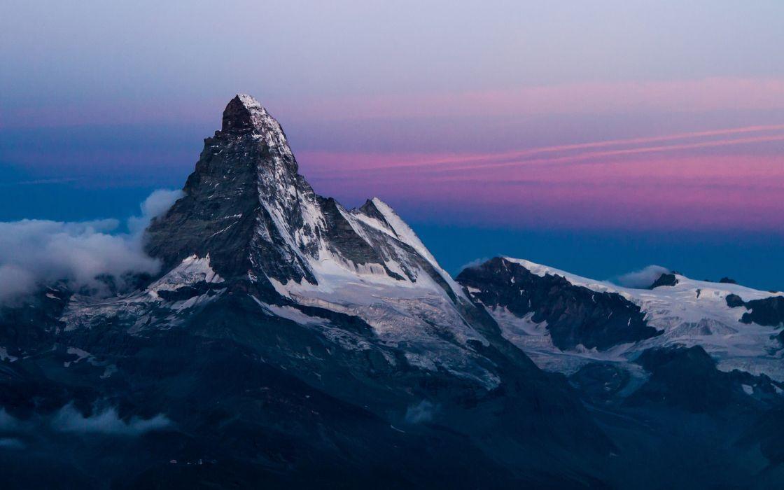 slope mountain peak rocks snow sky sunset sunrise wallpaper