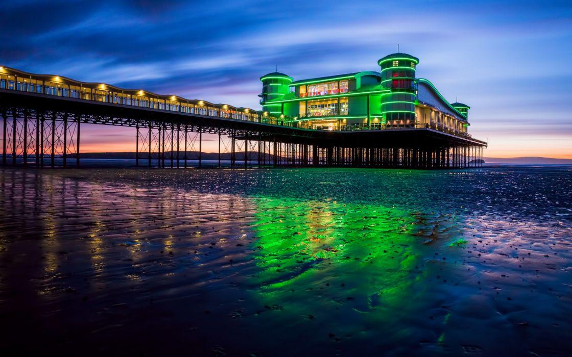 UK England beach bay sea pier lights lights evening sunset sky clouds architecture ocean wallpaper