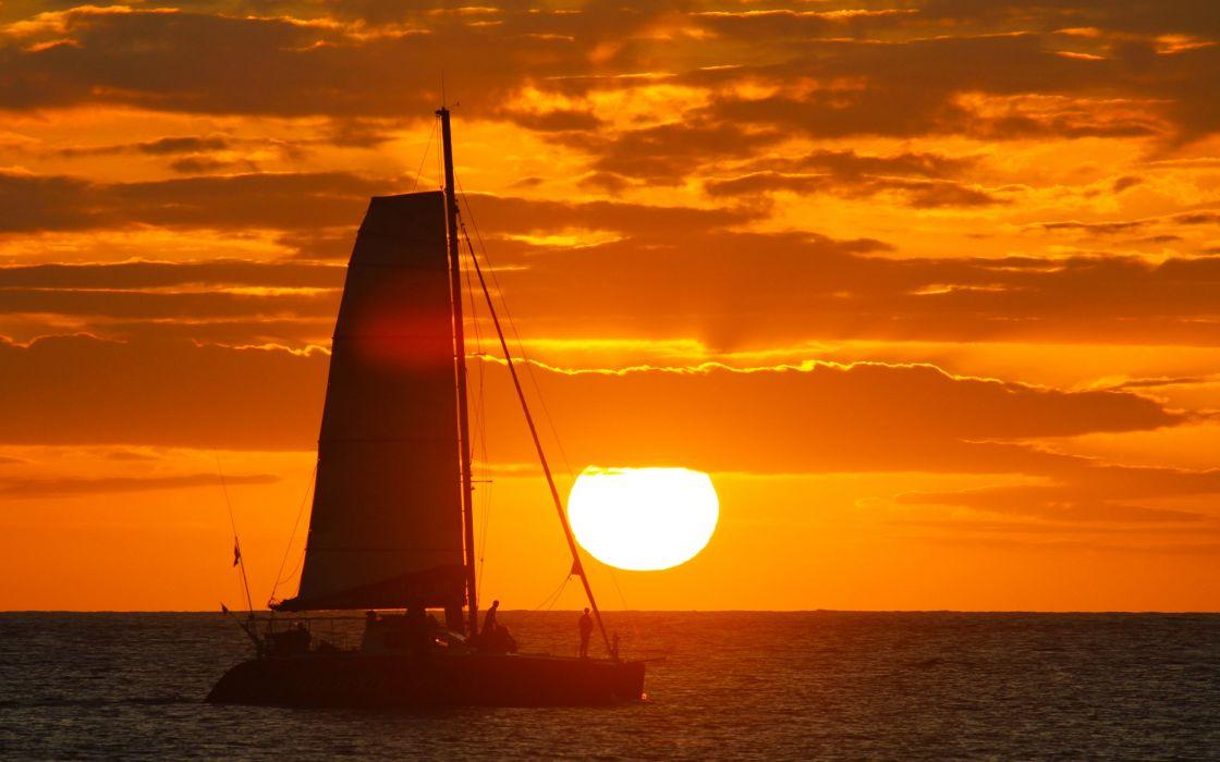sunset clouds nature Sun boats vehicles sea wallpaper
