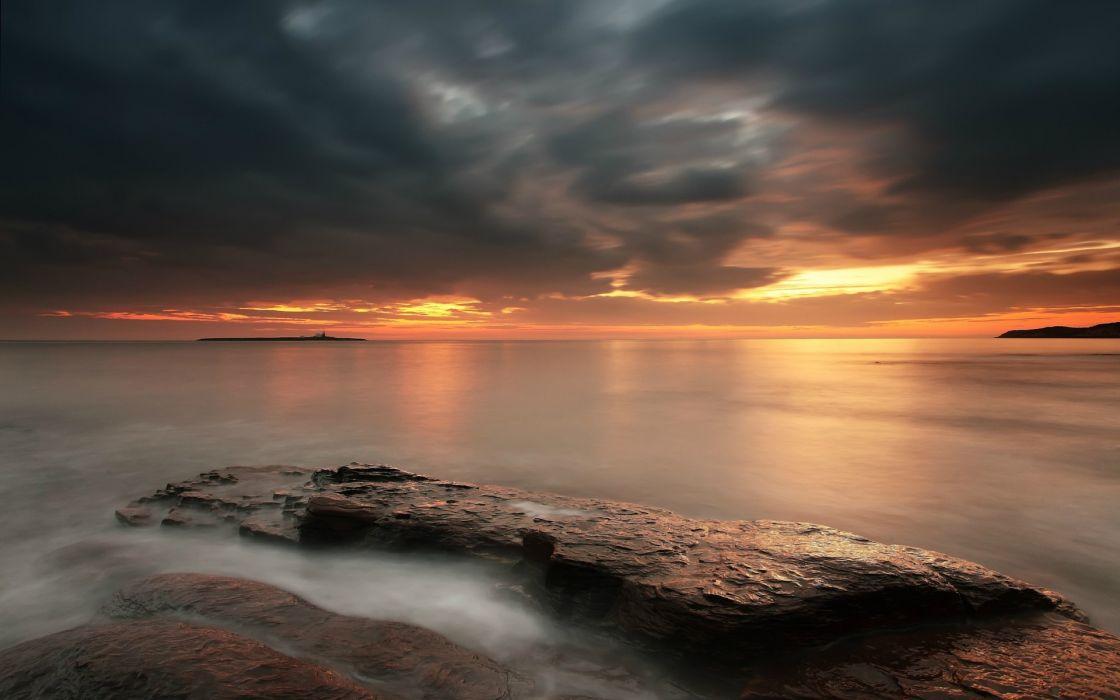 sunset clouds Sun skies sea wallpaper