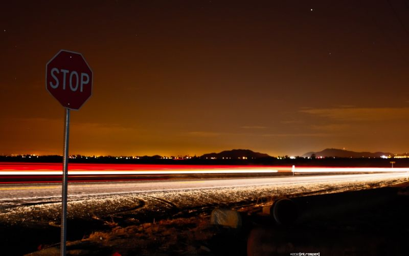 night desert roads The Edge long exposure stop signs light trails wallpaper