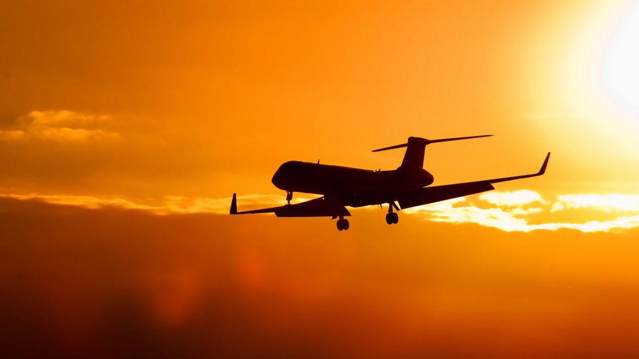 sunset clouds Sun aircraft aviation sillhouette CRJ-700 Bombardier wallpaper
