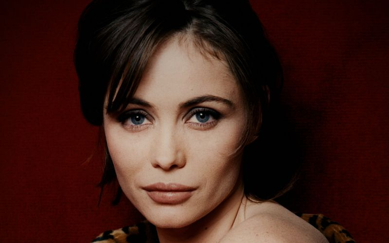 brunettes women actress French faces Emmanuelle Beart red background wallpaper