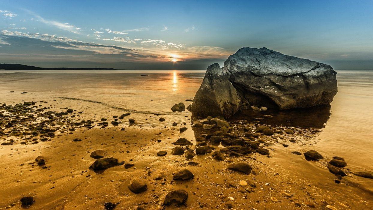 stones Sun Sun sand rocks sand sunset wallpaper
