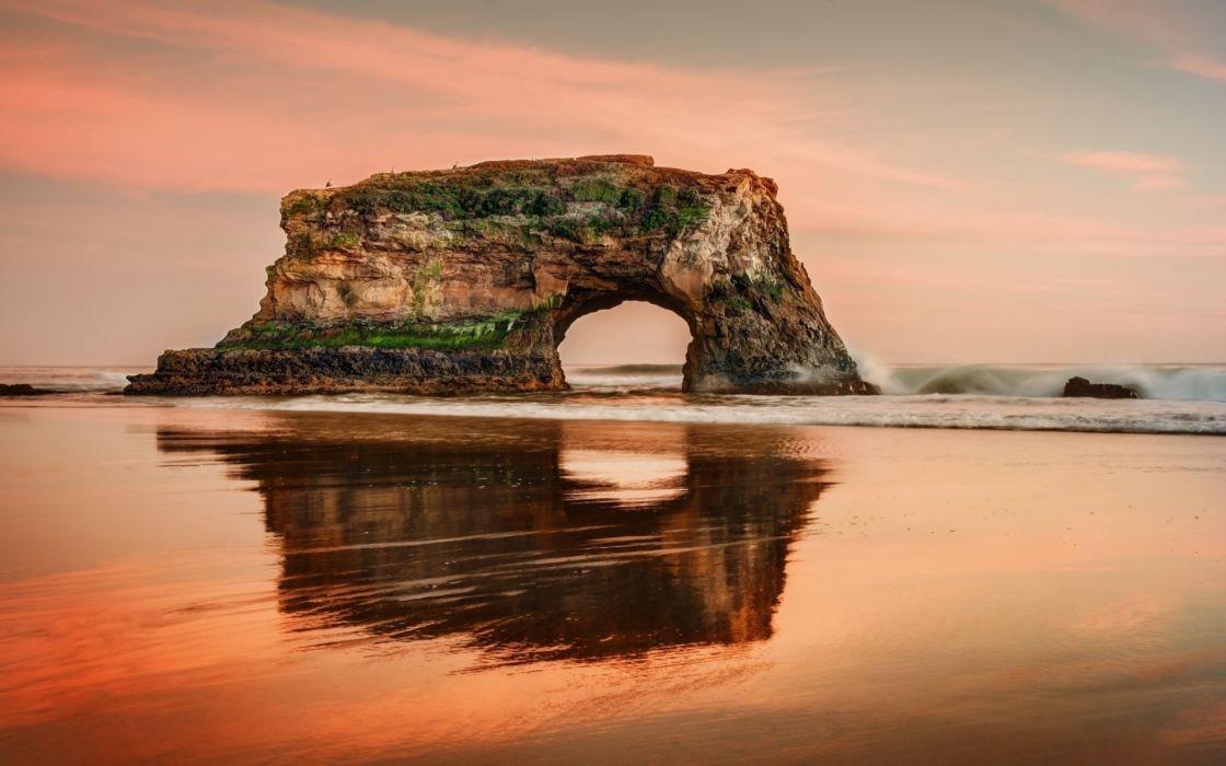 sunset rock ocean wallpaper