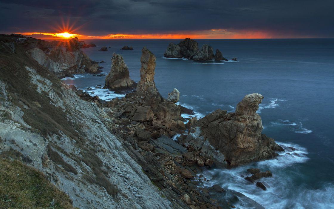 sunset sea rocks landscape ocean wallpaper