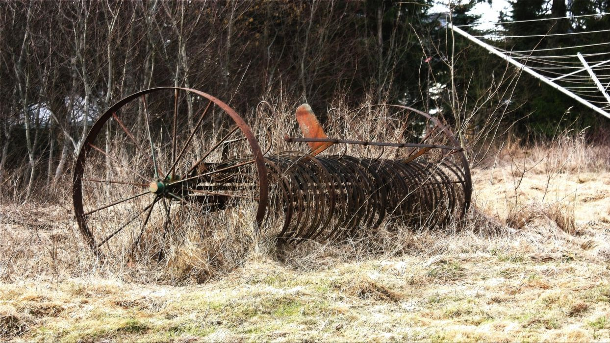 old rusted agriculture hay rake wallpaper
