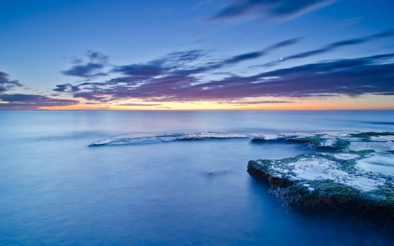Spain Valencia shore coast stones moss sea calm evening sunset blue sky clouds moon wallpaper