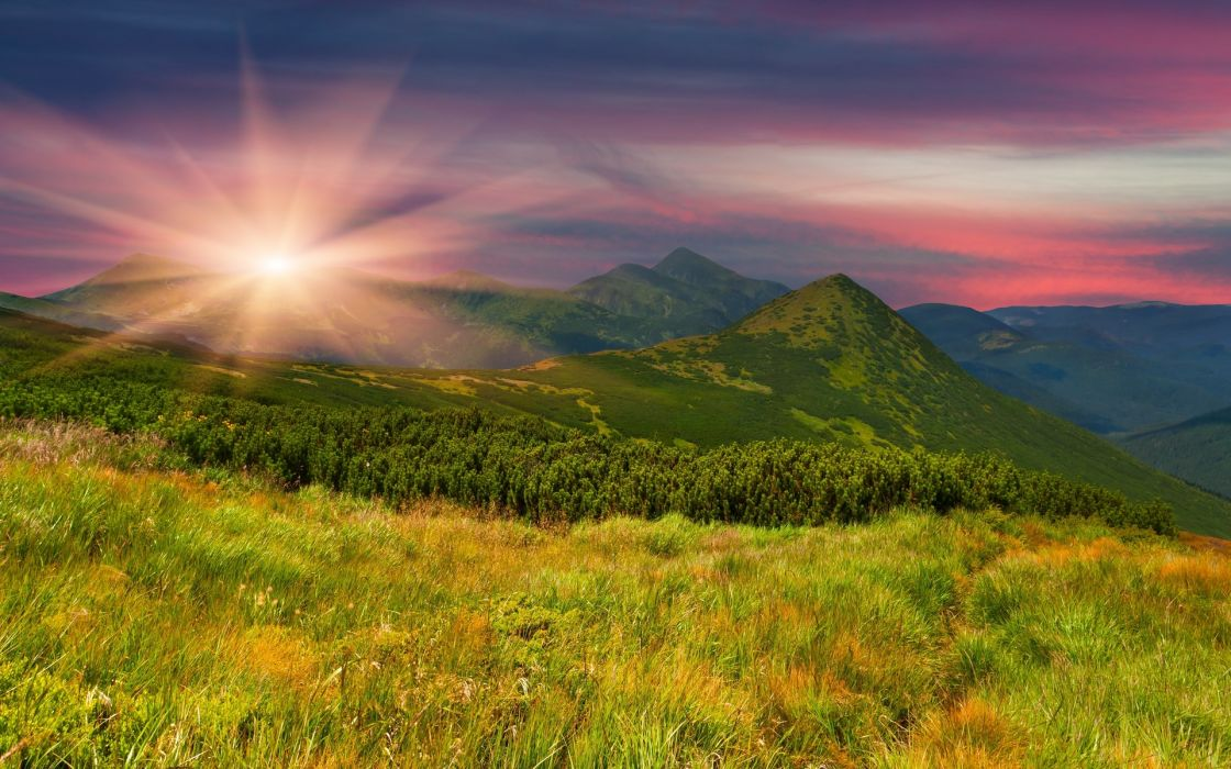 field mountains slope grass trees herbs evening sunset sun nature wallpaper