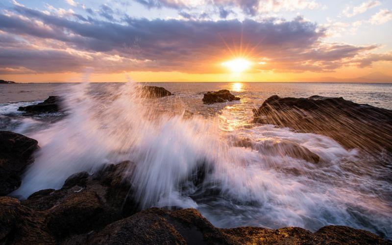 Japan Kanagawa Prefecture bay beach rocks surf evening sunset sun rays sky clouds wallpaper