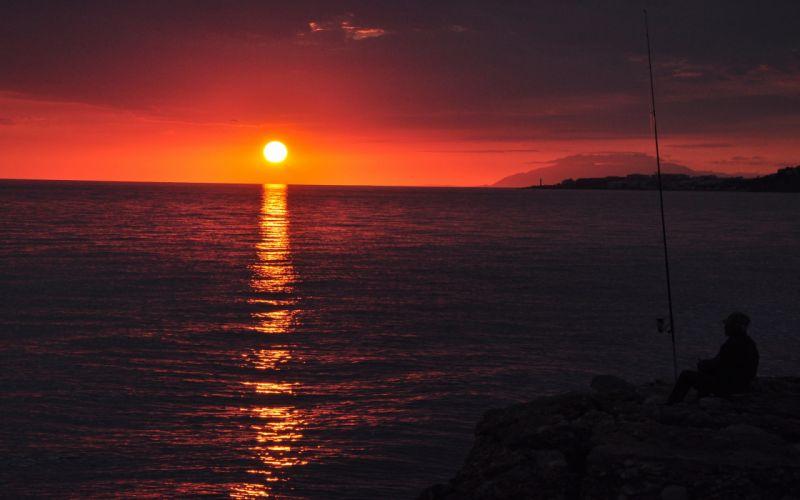 sunset sun fisherman fishing rod water sea lake wallpaper