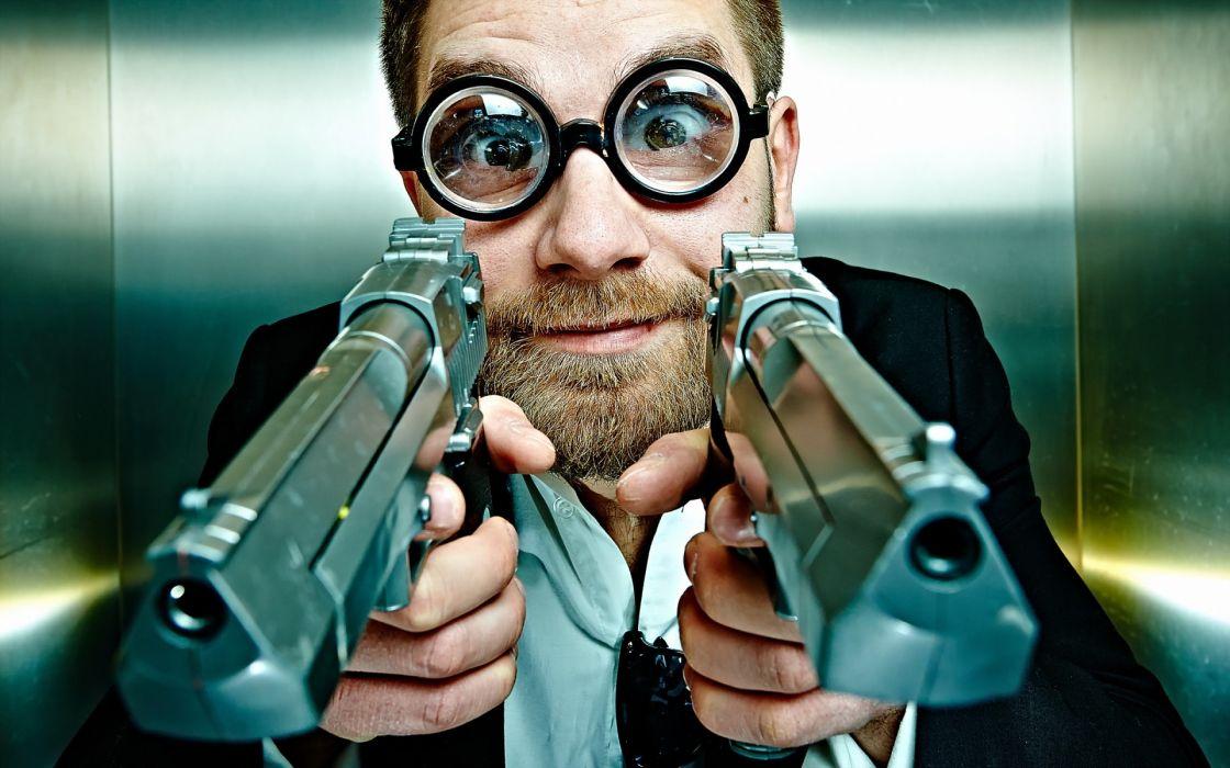people guns things weapons humor funny handguns weapons eyes glasses face eyes men males pistol wallpaper